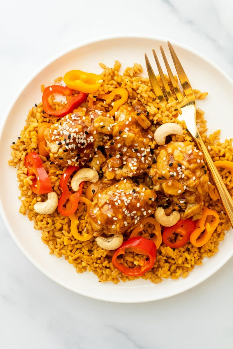 healthy baked orange chicken with peppers and rice