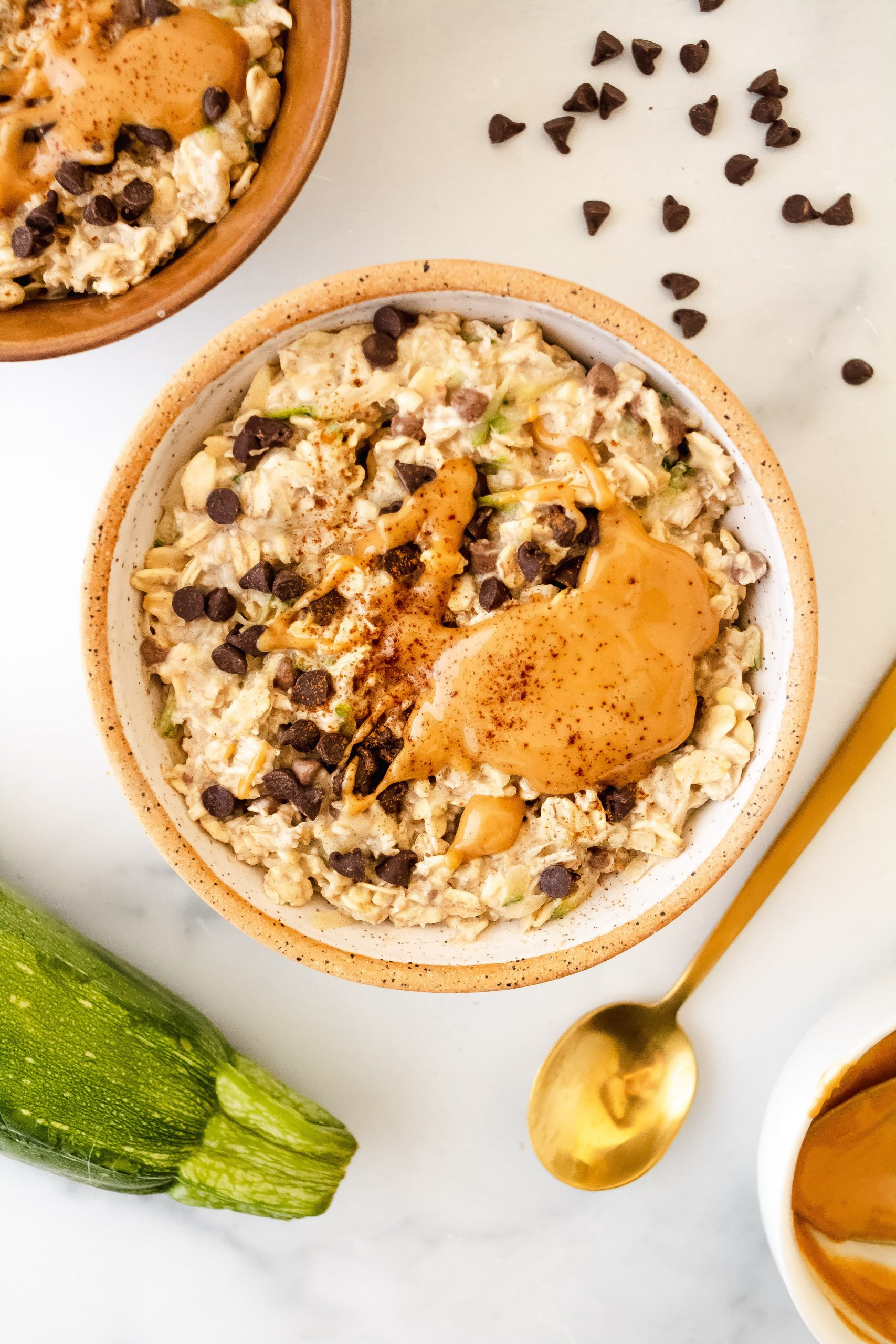 zucchini overnight oats with chocolate chips and creamy peanut butter