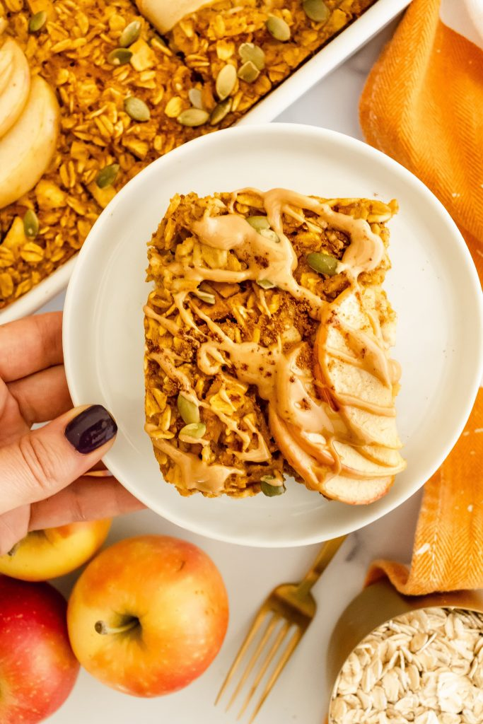pumpkin apple baked oatmeal with fall spices, pumpkin seeds and nut butter