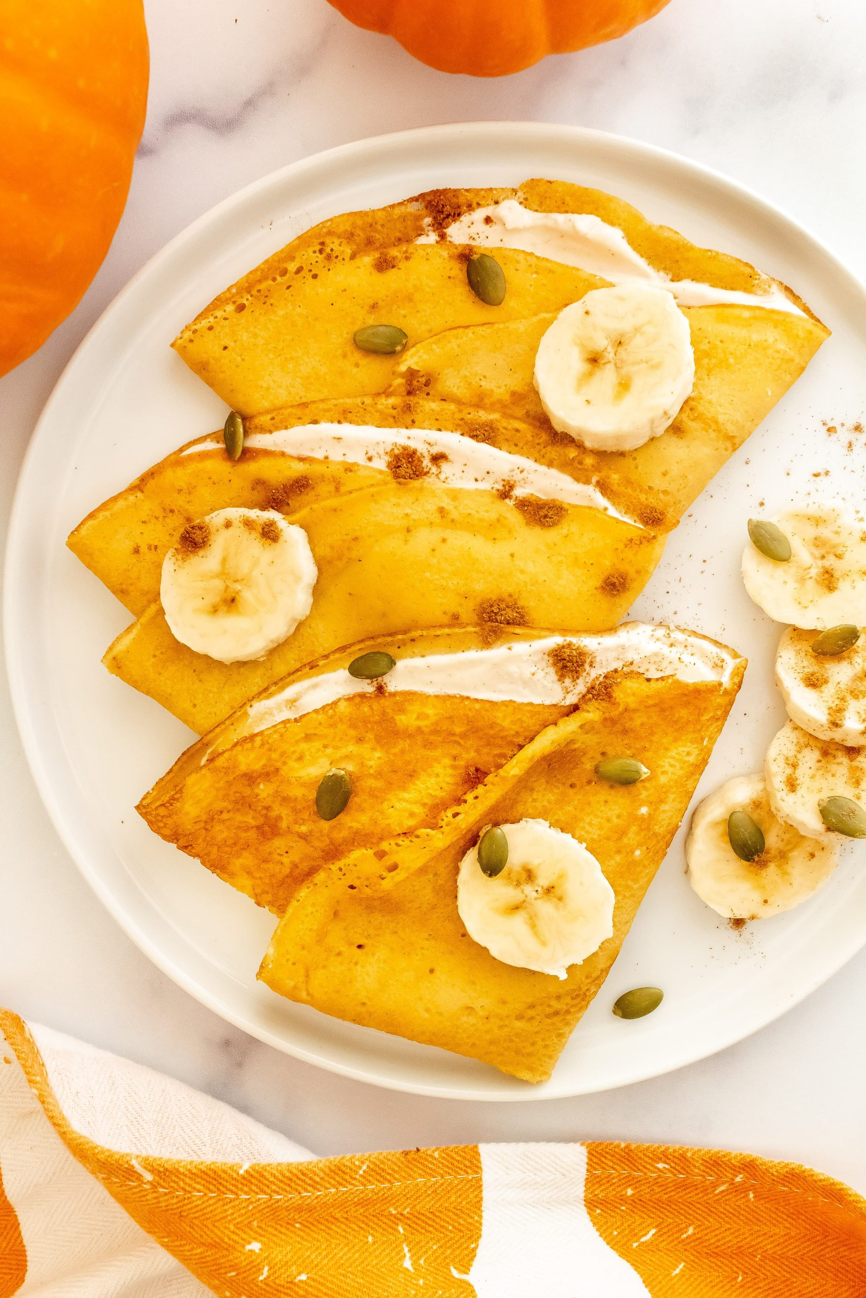 best fluffy pumpkin crepes with pumpkin yogurt filling topped bananas and pumpkin spice