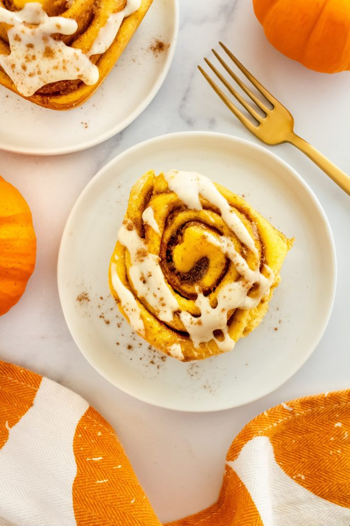 delicious pumpkin spice cinnamon rolls with salted pumpkin spice cream cheese frosting