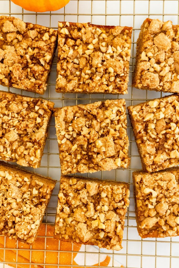 pumpkin pie bars made with whole wheat flour with a walnut crumble on top