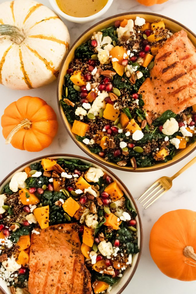 gluten free fall salad with salmon, butternut squash, kale, pomegranate seeds and quinoa