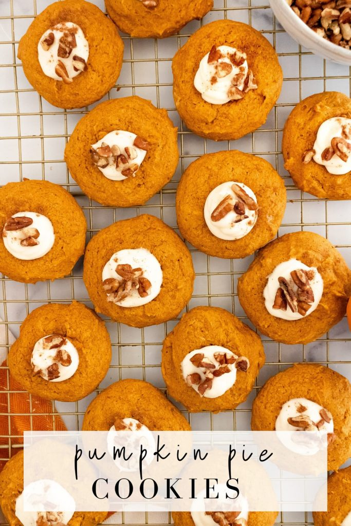 soft pumpkin cookies with a cream cheese middle and pecan pieces on top