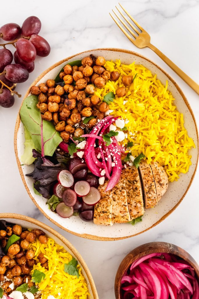 coconut turmeric rice power bowl with greens and garlic roasted chickpeas