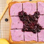 Moist lemon cake with blueberry yogurt frosting
