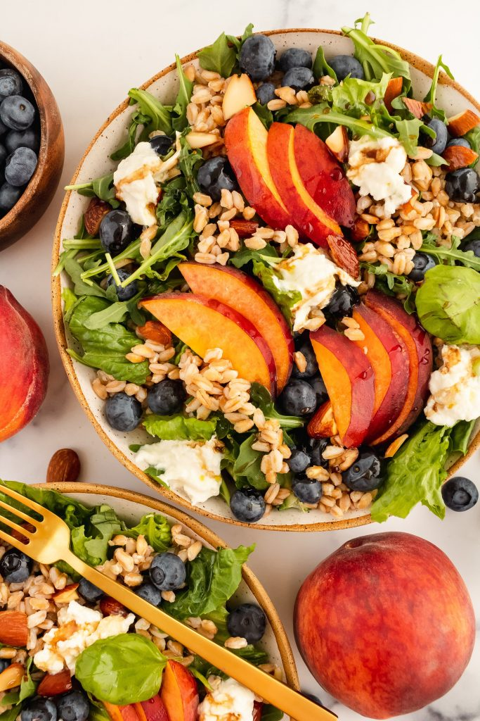 summer salad with blueberries, peaches, burrata, farro, almonds and balsamic vinaigrette