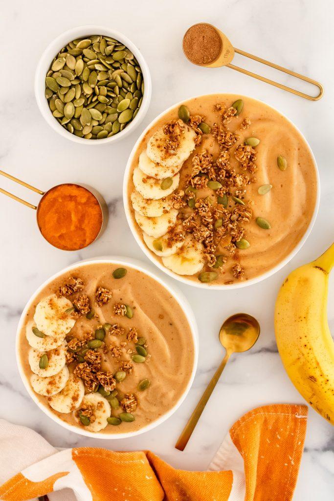 dairy free pumpkin smoothie bowl with pumpkin puree, banana, pumpkin pie spice and pumpkin seeds