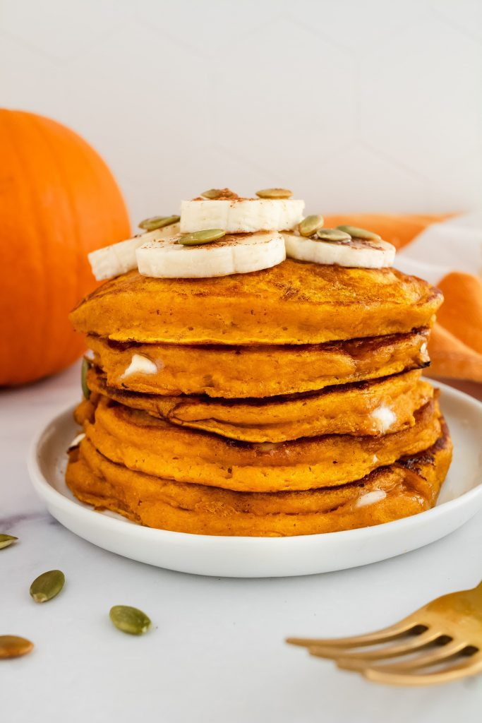 easy pumpkin pancakes with white chocolate chips and sliced banana