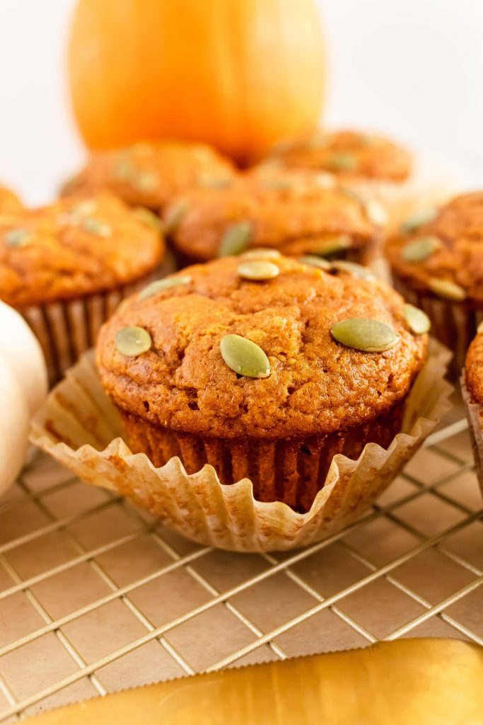 fluffy-and-moist-whole-wheat-pumpkin-muffins-topped-with-pumpkin-seeds